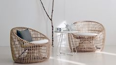 Beautiful in its symmetry, BOXHILL's Nest Rounded Club Chair adds a natural, warm element to your favorite space. The skilled craftsmanship of this piece along with its eye-catching lines make this chair a stand-out! See our complete line of elegant rattan furniture at www.shopboxhill.com