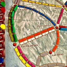 Get your ticket to ride a plastic train through as many cities as possible  Ticket to Ride   Days of Wonder  2-5 players, Ages 8 and up    $37 Buy a copy on Amazon   Ticket to Ride is one of my family's favorite board games. I was sucked in as soon as we opened up the box and unfolded the beautiful board, which features a map of the US and part of Canada with train tracks of various colors. The stubby game pieces, which keep track of your points, are these wonderfully simple wooden nubs painted Ticket To Ride, Us Map, Train Tracks, Game Pieces, Board Games, Maps, Cities, Canada, Plastic