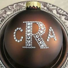 Every year, I monogram ornaments for friends using large glass Christmas balls in fun colors. I use two sizes of rhinestone sticker letters and the adhesive on sticker letters is super strong/permanent on glass. I have also done it with gold foil letters!  So easy and fun gift idea! #christmasornament #bhgstylemaker #bhgcelebrate