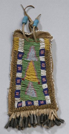 Beaded .strike a lite case w/ tin cone's and glass trade beads.