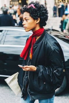 If a bomber jacket and jeans is your go-to look, add a simple knotted neck scarf.