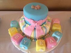 Calumet Bakery Gender Neutral Baby shower cake with baby blocks and gum paste baby
