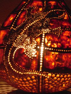 100% Handmade Gourd Lamp -The product is sanded and varnished. -Dyes are very quality. Colors fade.(dyes are acrylic and acrylic wood stain) -Wood-burning technique is used in products. -The lamp is made of dried gourd. -Decorated with carving . -Beads affixed. -You can give