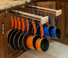 Pots & Pans Drawer This really caught my eye, it is a GREAT idea to store pots and pans so they are out of the way and easy to get to!