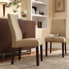With the comfortable cushioning and simplistic design of the wave back and legs, this Kiess parson chair set is ideal for your dining area or any room as an accent chair. The sleek modern mocha linen is designed to accommodate any decor.