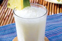 Batida de Coco - currently my favorite mixed drink. Bahama Breeze makes a mean one! Here's my version: 1 to 2 shots of Bacadi's coconut rum, 1 to 1 1/2 cans of pineapple juice (the small 6oz can), coconut cream to taste (it's super sweet, so use as wanted), ice. Mix & shake with ice, strain and pour over crushed ice. I never really measure, I just keep sampling until it tastes awesome.