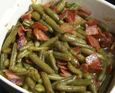 INGREDIENTS 6 thick slices bacon, chopped 1/2 cup onions, minced 1 teaspoon minced garlic 1 pound fresh green beans, trimmed 1 cup water 1/8 teaspoon salt 1 pinch ground black pepper DIRECTIONS Place bacon in a large, deep skillet. Cook over medium high heat until the fat begins to render. Stir in o…