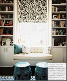 Exactly what I would like to do with the big window in the dining room.  Bench seat with storage ( for photo albums) surrounded by book cases with cupboards underneath. (For more photo albums!)