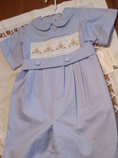 Size 4, One piece boy's smocked knee suit. Baby blue pinwale fabric, smocked with humpty dumpty. On Esty.