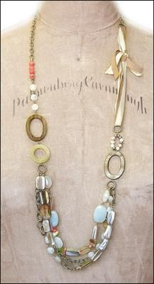 Suede ribbon, aquamarine, mother of pearl, coral, lemon quartz, carnelian, and plated brass.