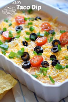 The Best Taco Dip with Cream Cheese & Salsa – A huge hit with family and friends. Done in minutes. Great for holiday gatherings, game day, and parties! Cold Taco Dip, Taco Dip With Meat, Nacho Dip, Cream Cheese Taco Dip, Sour Cream Dip, Cheese Tacos, Nachos, Best Taco Dip Recipe, Low Carb Taco Seasoning