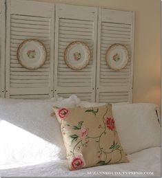 salvaged shutter headboard with vintage plates