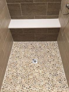 Glazed Java Tan Pebble Tile Shower Pan I like this color for the master shower floor Master Shower, Master Bathroom, Bathroom Small, Small Tile Shower, Seashell Bathroom, Ikea Bathroom, Guys Bathroom, Attic Bathroom, Simple Bathroom
