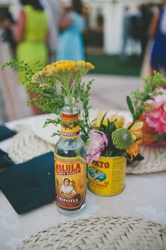 jars, bottles, and cans as vases