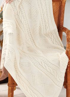 Free Knitting Pattern for Treasure Chest Throw - Aran afghan knit in strips of cables and diamond motifsand seamed. Size47″ x 54″. Designed by Red Heart.
