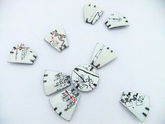 KATIE OWEN-UK Jewellery - Hinterland 9 piece brooch series Enamelled and oxidised copper