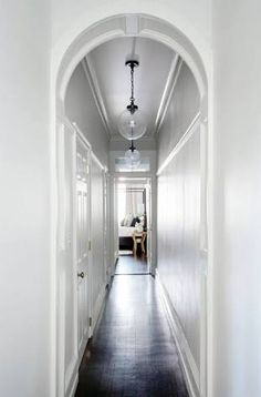A Centuries Old Home gets Some Serious Love Hallway/entrance: high ceilings, arch, wall panelling/moulding, glass ball pendant lights, dark timber floorboards hallway lighting Dark Hallway, Modern Hallway, Long Hallway, Upstairs Hallway, Entry Hallway, Hallway Ideas, Entryway Ideas, Entryway Decor, Entryway Stairs