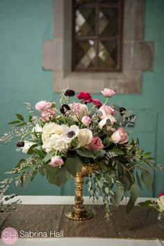 Upscale wedding flower centerpiece by the Garden by the Gate florist. Photo sabrina Hall Photography, Venue: Glenmoor County Club