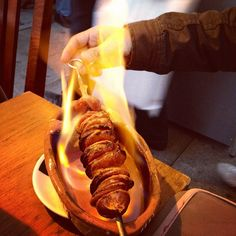 Flaming sausage at Chez Lapin in Oporto, Portugal