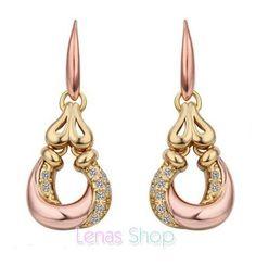 Boucles d'oreille plaqué or jaune et rose 18 carats, bijou à design unique très mode avec des oxydes de zirconium.
