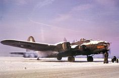 """Ground personnel watch a B-17 Flying Fortress (FR-M serial number 42-30298) nicknamed """"Ragin' Red II"""" of the 379th Bomb Group start up in snow at Bassingbourn January 1945."""