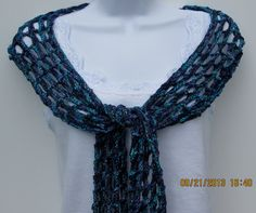 Hand knit silky ribbon scarf in shades of blue and turquoise. Open weave stitch, summer scar, fashion scarf