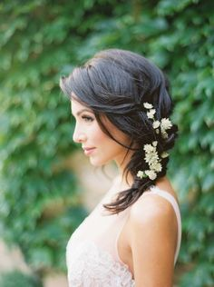 Pretty loose side wedding hairstyle