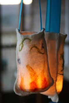 Felted Lanterns (for Martinmas) - nuno felt, long handles, mason jar with tea light. She did these with her kids - how cool is that!