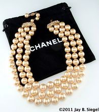 CHANEL Triple Strand Faux Pearl Necklace with Rhinestone Closure