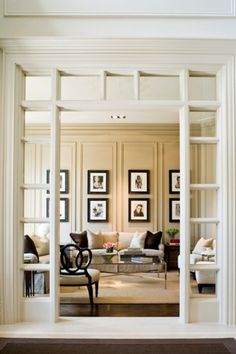 great formal living room, I love the archway.  Entry & paneled wall love it all