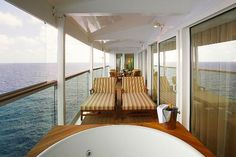 Relax in the private whirlpool of a Royal Suite on Liberty of the Seas.