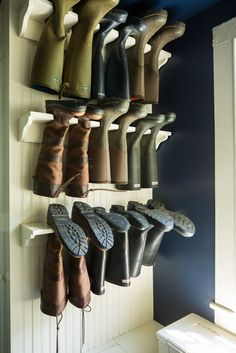 Boots hanging in the mudroom off the kitchen.