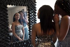 Zakiah Murphy,12, right, and Victoria Rodriguez,14, try on donated prom dresses at home of Angela Hines, founder of Project Window, on April 3, 2016.  Hines is an attorney who grew up in NYCHA projects in Rockaway and volunteers to give back to young under privileged girls growing up in similar environment who would never be able to afford these donated dresses.