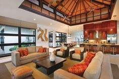 Open plan living with Balinese influences.  Eloise Kubli, Collective Construction & Design, Inc., Plantation, FL