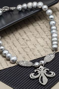 Silver Pearls made just for you. This gorgeous necklace is made to order by skilled artisans in Los Angeles, California. It features 17 inches of silver freshwater pearl, silver crystal Swarovski Cuvee pendants and Swarovski Grand Fleur medallion. Can be worn to any birthday dinner, date, brunch party, business meeting, work event, holiday gathering, coffee run or formal affair. Click through to SHOP online. #pearls #necklaces #style Pearl Jewelry, Pearl Necklace, French Kande, Business Meeting, Brunch Party, Silver Pearls, Swarovski, Just For You, Gems