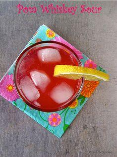 Pom Whiskey Sour-ice 1  whole lemon, plus additional slices for garnish 2 teaspoons sugar 2 tablespoons POM pomegranate juice 2 shots Scotch whiskey 12 oz Sprite or club soda