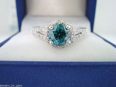 HERE IS HANDMADE NEW MODEL ENGAGEMENT RING !! 14 KARAT WHITE GOLD CENTER SI1 BLUE DIAMOND 0.99ct !! VERY SWEET BLUE COLOR & CLEAN DIAMOND !!!!!! CENTER SHAPE- ROUND CUT- VERY GOOD CARAT- 0.99ct COLOR- BLUE CLARITY- SI1 MEASUREMENT- 6.25mm SIDE 41 WHITE DIAMOND 0.34 CARAT