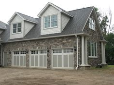 Garage done in Bucks County Limestone from Boral Cultured Stone & Installed by Brighton Stone & Fireplace.