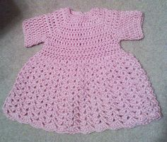 """Just made. Crocheted Pink baby Dress. Very soft. size 6 months, waist 17"""", Length 13"""", neck 11"""" contact me for more information."""