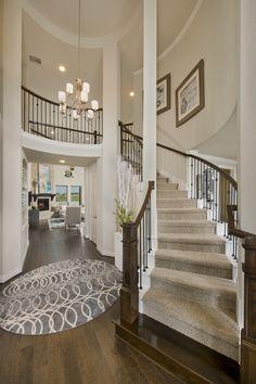 Cross Creek Ranch Model Home Open Daily - 4,098 Sq. Ft. - Foyer & Grand Staircase - #PerryHomes #trustedbuilder #homebuying #homebuilding #CrossCreekRanch #FulshearTX #KatyISD #KatyHomes #KatyTX #HoustonHomes #openconcept #openfloorplan #familyhome #realestate #RelocatingtoHouston #lakesidecommunity #lakesideliving #landscaping #brickexterior #stoneexterior #staircase #curvedstaircase #foyer #hardwoodflooring