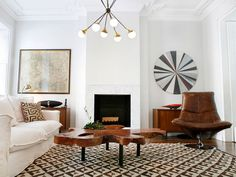 love it all.  the leather chair, the cocktail table, the slipcovered sofa, the rug, but especially the light fixture!