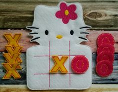H. Kitty Tic tac toe game made and sold by Heart Felt Embroidery. $10.00! www.facebook.com/heartfeltembroidery  Purchase at www.heartfeltembroidery.net