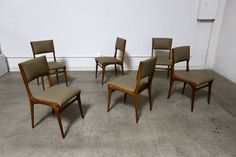 Set of Six Sculptural Italian Dining Chairs by Carlo de Carli   From a unique collection of antique and modern dining room chairs at https://www.1stdibs.com/furniture/seating/dining-room-chairs/