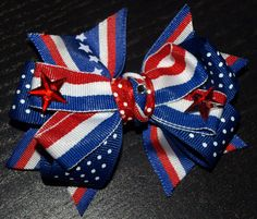 My Little Bows- the perfect accessory for memorial day, july 4th, the olympics, and all summer. red white and blue star bow by mylittlebows on Etsy, $8.00