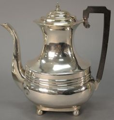 English silver tea pot on ball feet with wood handle. ht. 8 3/4 in.; 19 t oz.