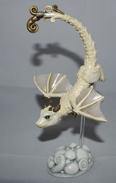 A cloud dragon whelp with a cloud stand. Made from polymer clay