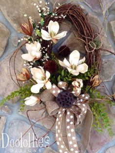 Item Details ⋆ ⋆ ⋆ ⋆ ⋆ (1) Shipping & Policies . Nothing says southern better than sweet magnolias, and this elegant oval shaped grapevine wreath is filled with magnolias. The creaam colored magnolias and burlap ribbon will go with pretty much any decor and adds a little touch of southern elegance to your home.