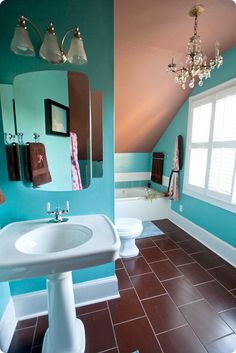 Brown floor, turquoise walls, tan ceiling, white fixtures