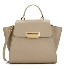 """ZAC Zac Posen™ Beige Eartha Soft Top-Handle Satchel $495 Leather Imported 100% Leather lining Turn Lock closure 12.5"""" shoulder drop 10.5"""" high 11.5"""" wide Spacious satchel with multiple straps with piping trim and gold-tone hardware feet Dual shoulder straps"""