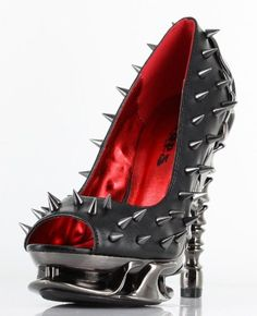 A rock'n spike cover pump with a the new chrome spinal heel to dazzle all who lay eyes on your feet.- Heel Height - 4 in, platform front .75 inches- Covered in Spikes- Peek-a-boo toe- Chrome Spinal Heel that flows into the front platform area- Note: If you are a half size we recommend going one size up $133.84